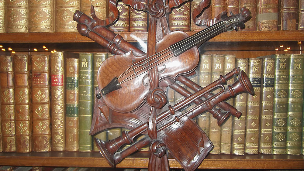 VISITOR Archive Violin Bookcase 1000px x 563px
